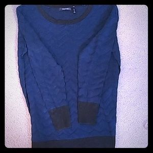 Cute sweater with blue and black zigzag pattern